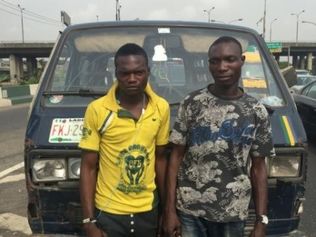Photo: Danfo Bus Driver & Condutor Arrested For Painting Vehicle In Lagos Police Colours