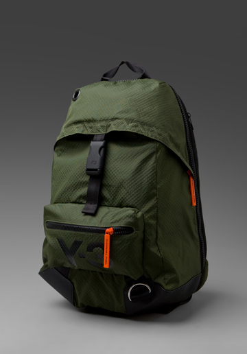 55e4ebdec826 Y-3 Yohji Yamamoto Backpack. The military inspired color scheme with orange  accents make this bag unique in a world of basic backpacks.