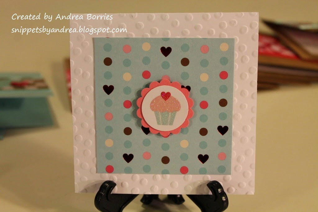 Valentine with polka dot embossed base, polka dot printed paper and a cupcake image punched out with a circle punch for the focal point.