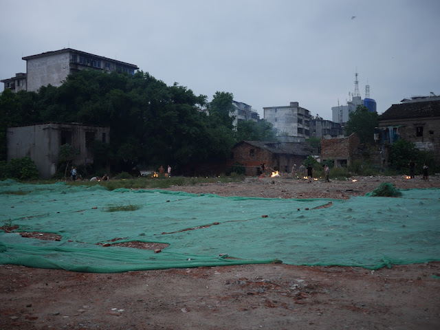 vacant lot where buildings had been demolished being used for religious offerings