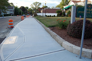 new sidewalk in front of the Ginley Funeral Home