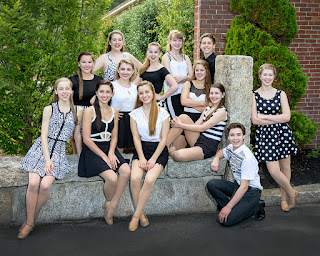 The 13 singer-dancers of Electric Youth 2015 are pictured in this portrait photo