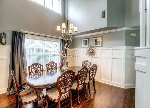 wood plank tiles in dining room.