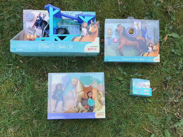 four spirit riding free toys still in  packaging