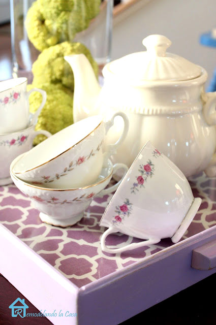 purple tray with tea pot and tea cups on it - hedge apples background