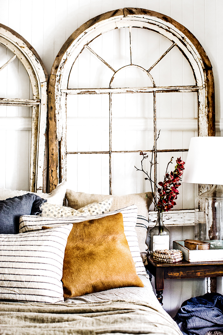 Rustic Bohemian Interior Design in a Bedroom by Kara Rosenlund layered with vintage finds and rustic beachy goodness. #vintagestyle #bedroom #rusticdecor #boho