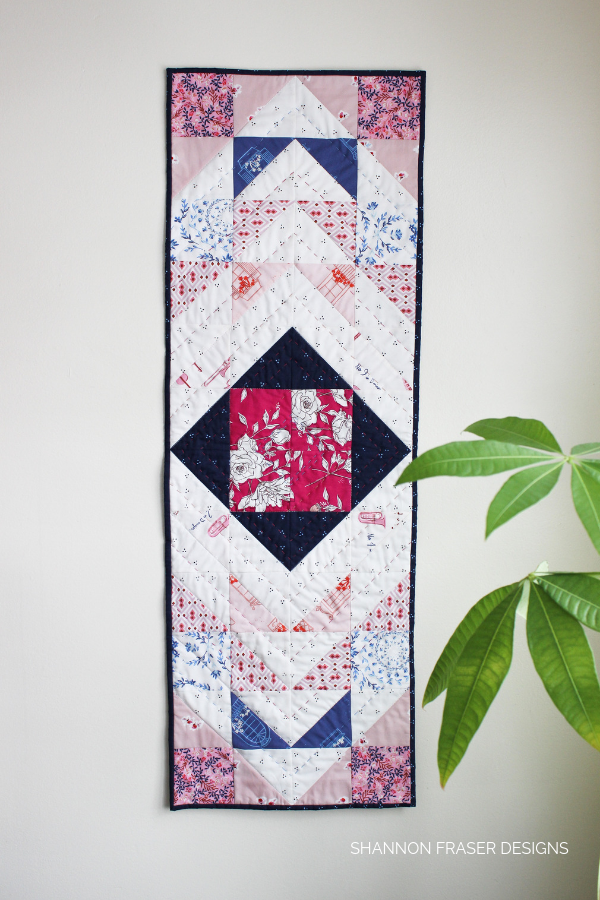 Sonata Showcase Modern Aztec Table Runner hanging