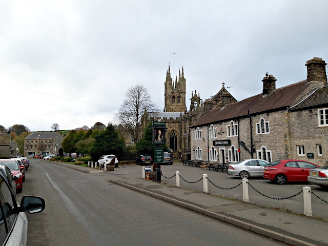 Looking down Commercial Street, Tideswell.  The George Inn is to the right of the photo and the church is in the centre.