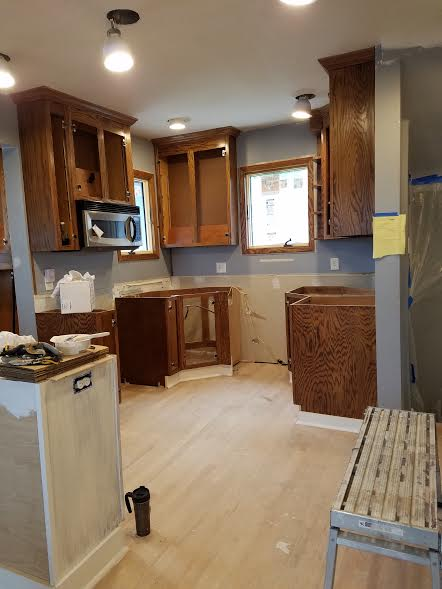 rokel painting: oak cabinets dated kitchen