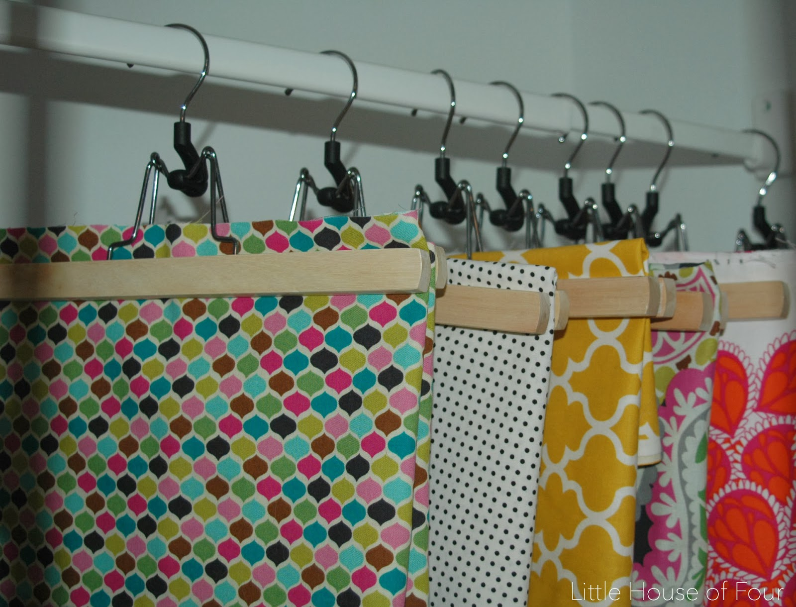 Hanging fabric with pant hangers