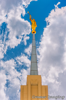Cramer Imaging's professional quality fine art photograph of the Twin Falls Idaho temple spire against the sky with clouds