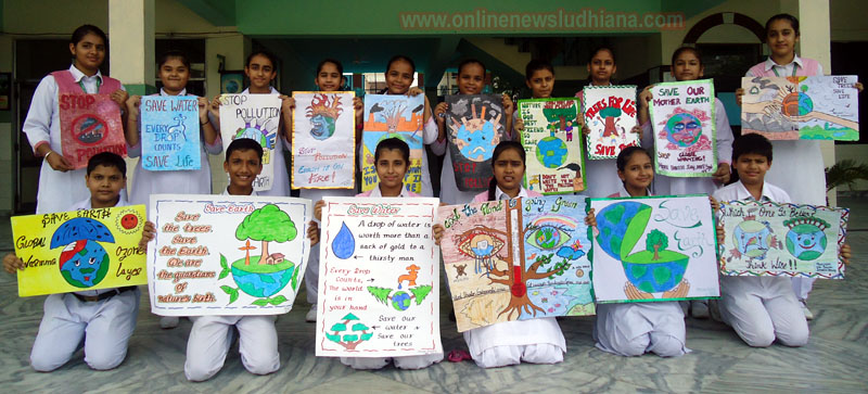 Students shows posters made by them during Van Mahotsava Week at Green Land