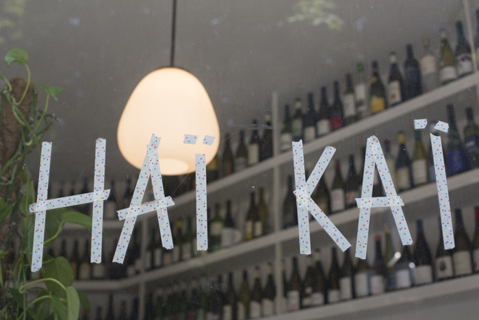 Hai Kai store front with tape sign is whimsical and fun