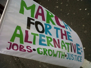 Emsy's 'March for the Alternative: Jobs, Growth, Justice' flag