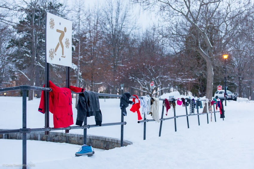 Portland, Maine USA December 2016 photo Corey Templeton of Scarf Mob winter clothing donations in Deering Oaks Park.