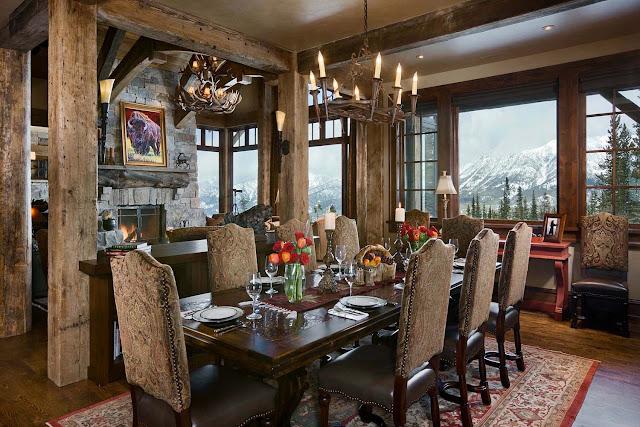 Современные дома. Загородный шикарный дом в окружении скалистых гор