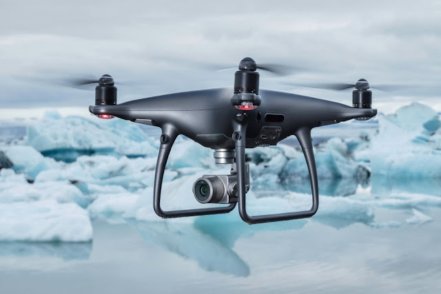 DJI took payoff of IFA inwards Berlin to denote a few novel products Dji Phantom four Pro Obsidian Review - What Is the Differences