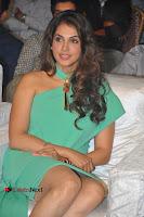 Actress Isha Koppikar Pos in Green Dress at Keshava Telugu Movie Audio Launch .COM 0012.jpg