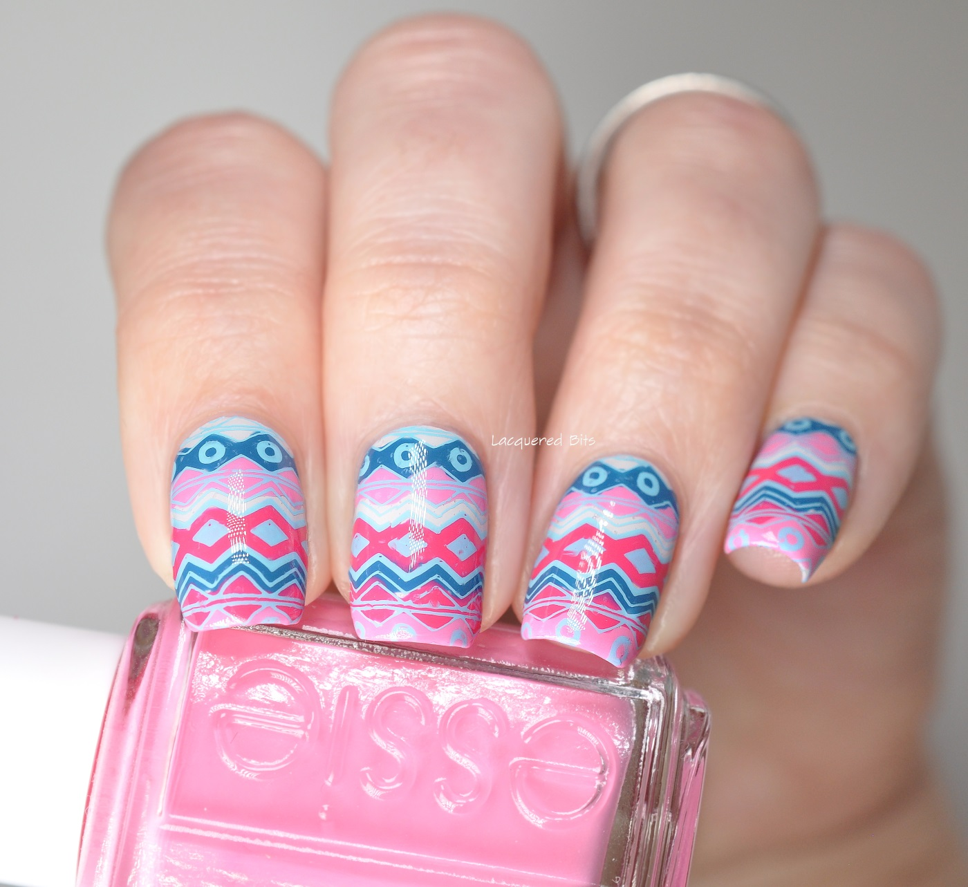 Blue and Pink Tribal Nails made with reverse stamping