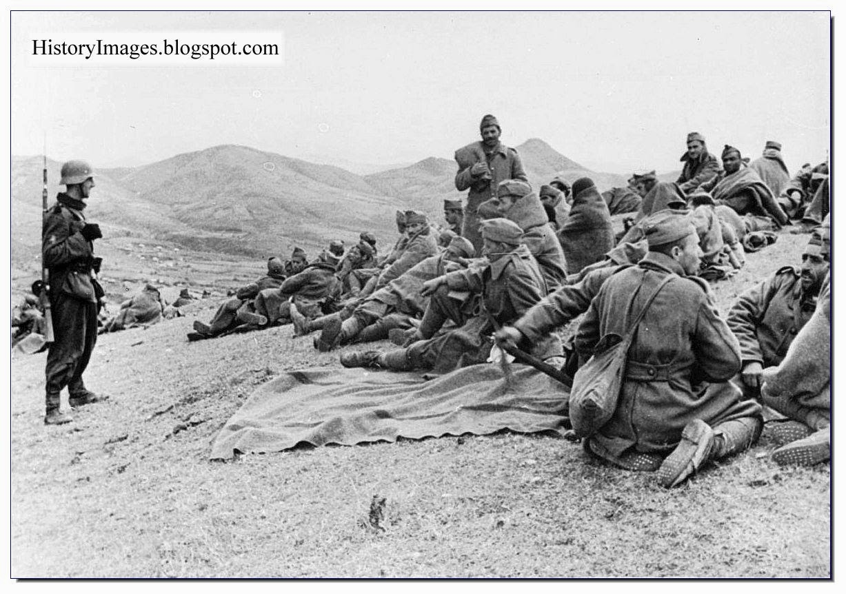 Rare WW2 Images Greek soldiers taken prisoner sit around  German guard watches