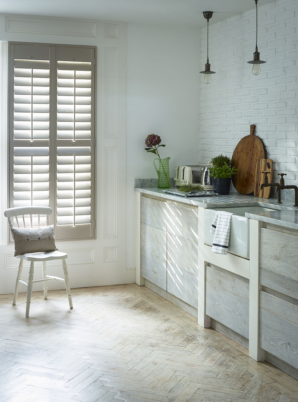 Shutterly Fabulous - French For Pineapple Blog - Neutral Plantation Shutters in beautiful neutral kitchen with oak cabinets, parquet flooring and marble worktop
