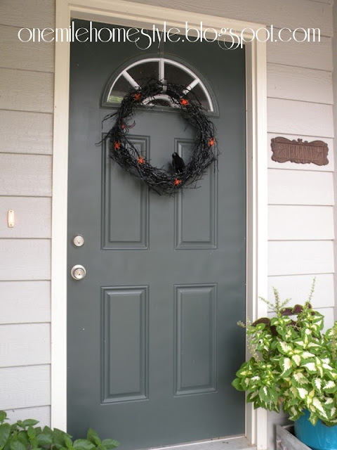 Black Halloween wreath on front door