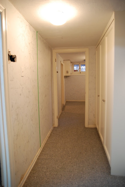 basement renovation, bright basement, basement lighting, white basement, basement layout