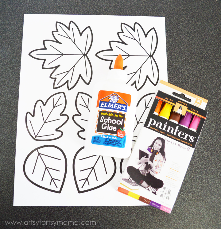 Kids DIY Autumn Leaf Wreath at artsyfartsymama.com #fall #kidscraft #Elmers