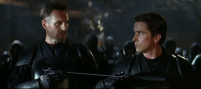 Liam Neeson and Christian Bale as Henri Ducard and Bruce Wayne in Batman Begins
