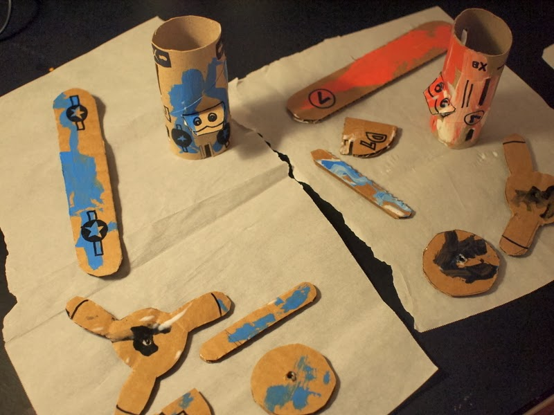 Toilet roll airplane pieces painted and drying