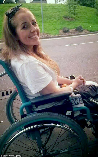 A smiling woman in a wheelchair