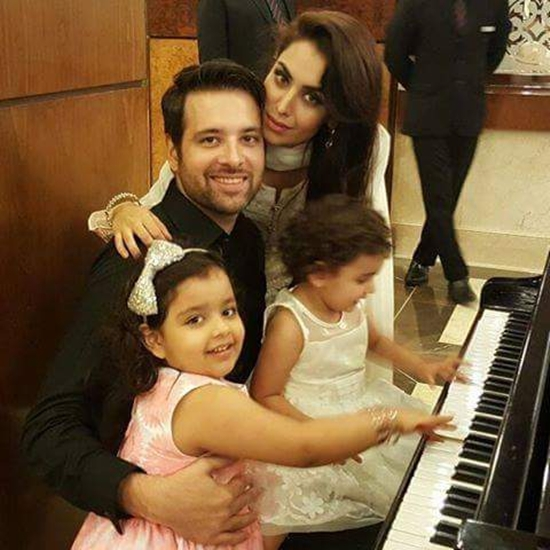 Mikaal Zulfiqar with his wife and daughters