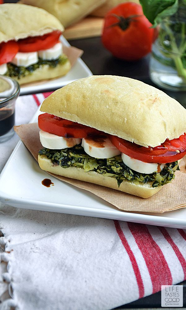Caprese Sandwich | by Life Tastes Good is a simple recipe that is big on flavor! The softest, most delicious ciabatta roll topped with fresh basil pesto, tomatoes, and creamy mozzarella cheese all drizzled with balsamic vinegar just might be my new favorite sandwich! My mouth is watering just thinking about it! #LTGRecipes