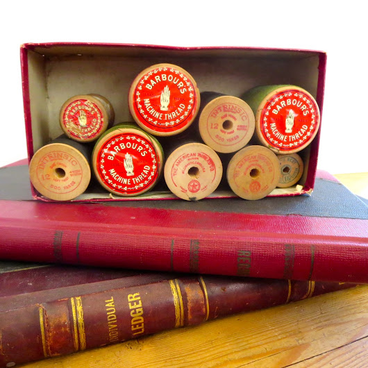 Vintage thread on wooden spools with great graphics.