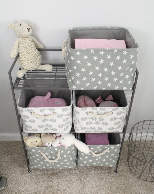 Gray white and light pink nursery for a baby girl- Canvas and rope storage baskets with stars and elephants
