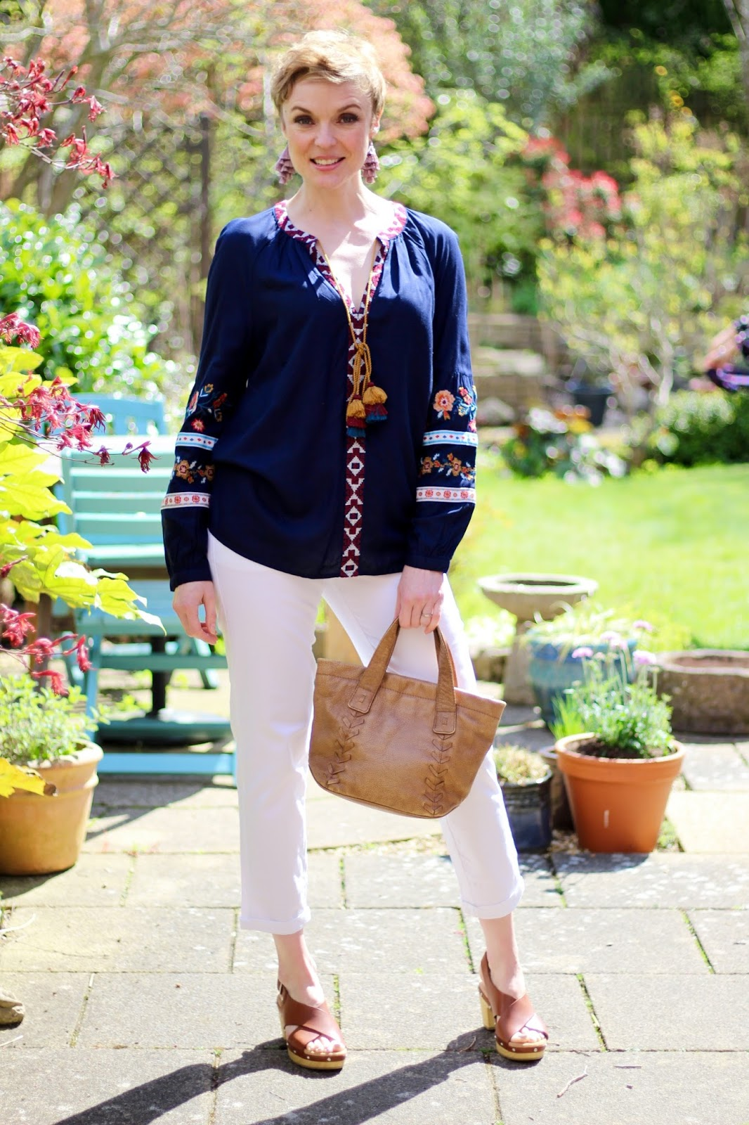 Navy Embroidered Boho Blouse, White jeans, Tan Clog Sandals | Fake Fabulous