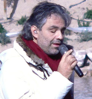 Andrea Bocelli performing a concert outdoors in the  United States, where he has a big following