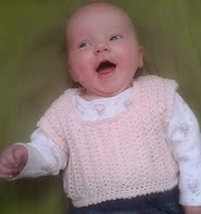 http://www.ravelry.com/patterns/library/vinca-sweater-vest---sizes-newborn-to-3-years
