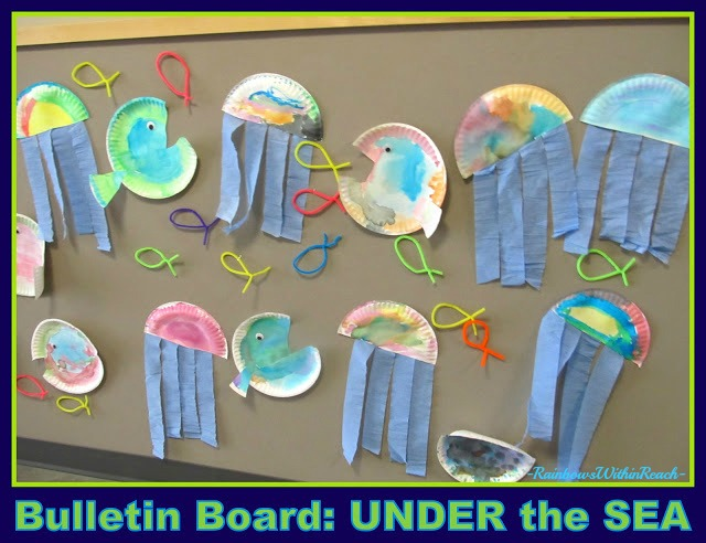 "photo of: Ocean Bulletin Board of Jellyfish and Fish (on paper plates) for Summer Arts and Crafts at ""PreK+K Sharing"""