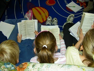Children reading story books.