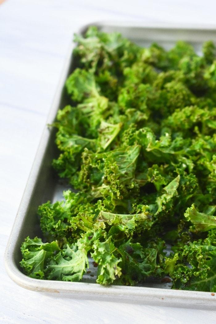 a baking sheet full of kale