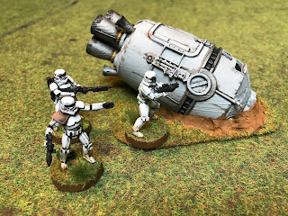 Stormtroopers check the ewscape pod for signs of life