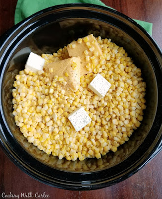 corn, butter and cheese in slow cooker crock