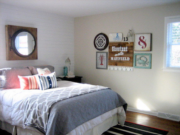 Adding an eclectic gallery wall to a master bedroom.