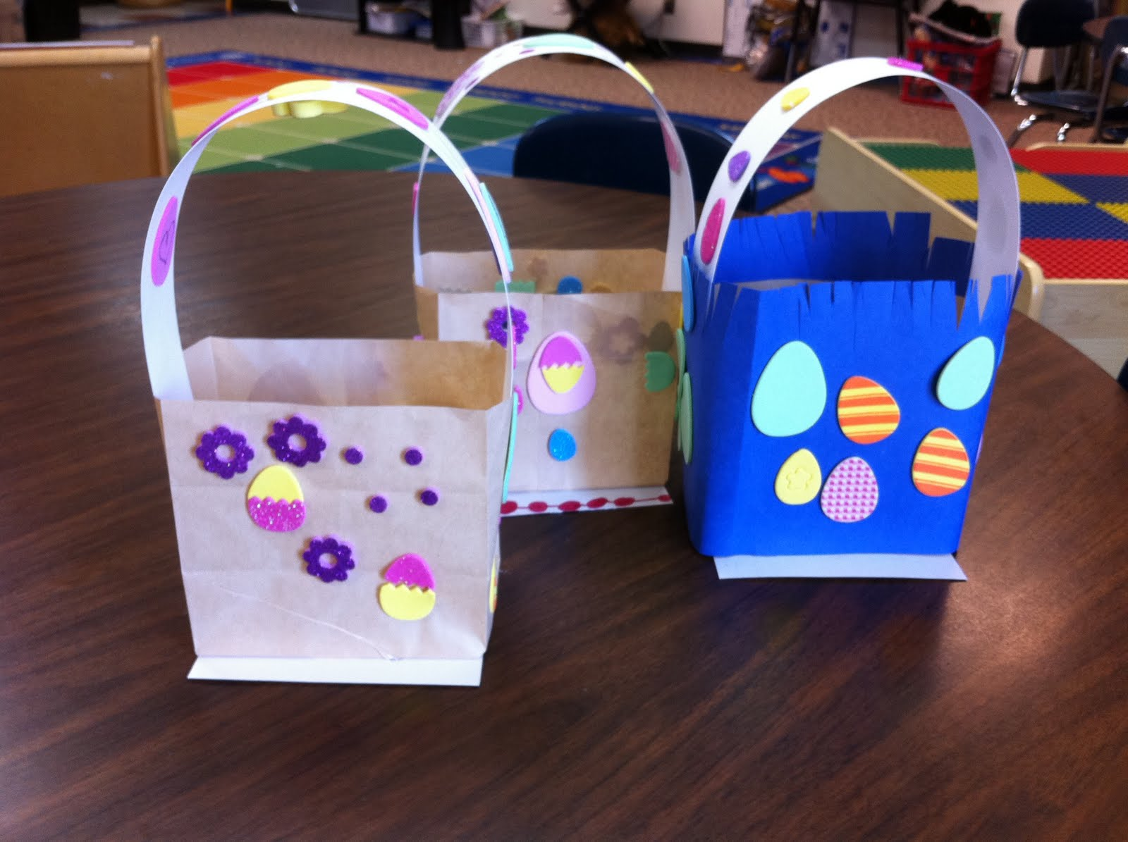 All you do is cut a curved section out of each side of the bag, and then take the two long pieces at the top and tape or glue them together to form the handle. Thus the name QUICK and EASY Paper Bag Easter .