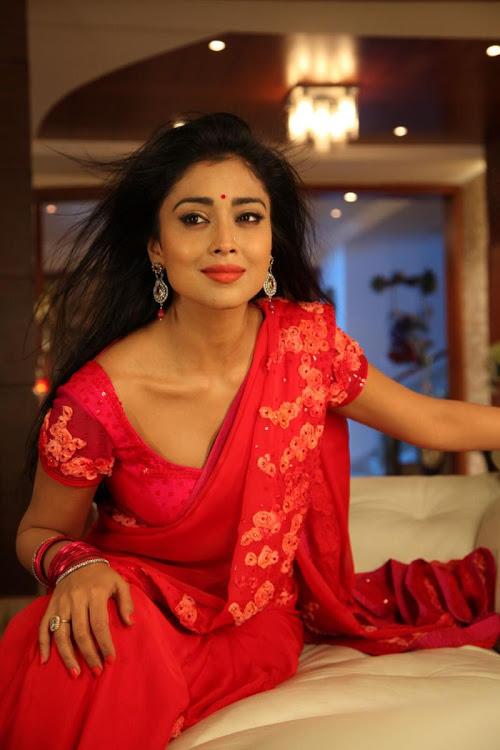 Shriya Saran in red hot Saree Stills for Pavithra Movie
