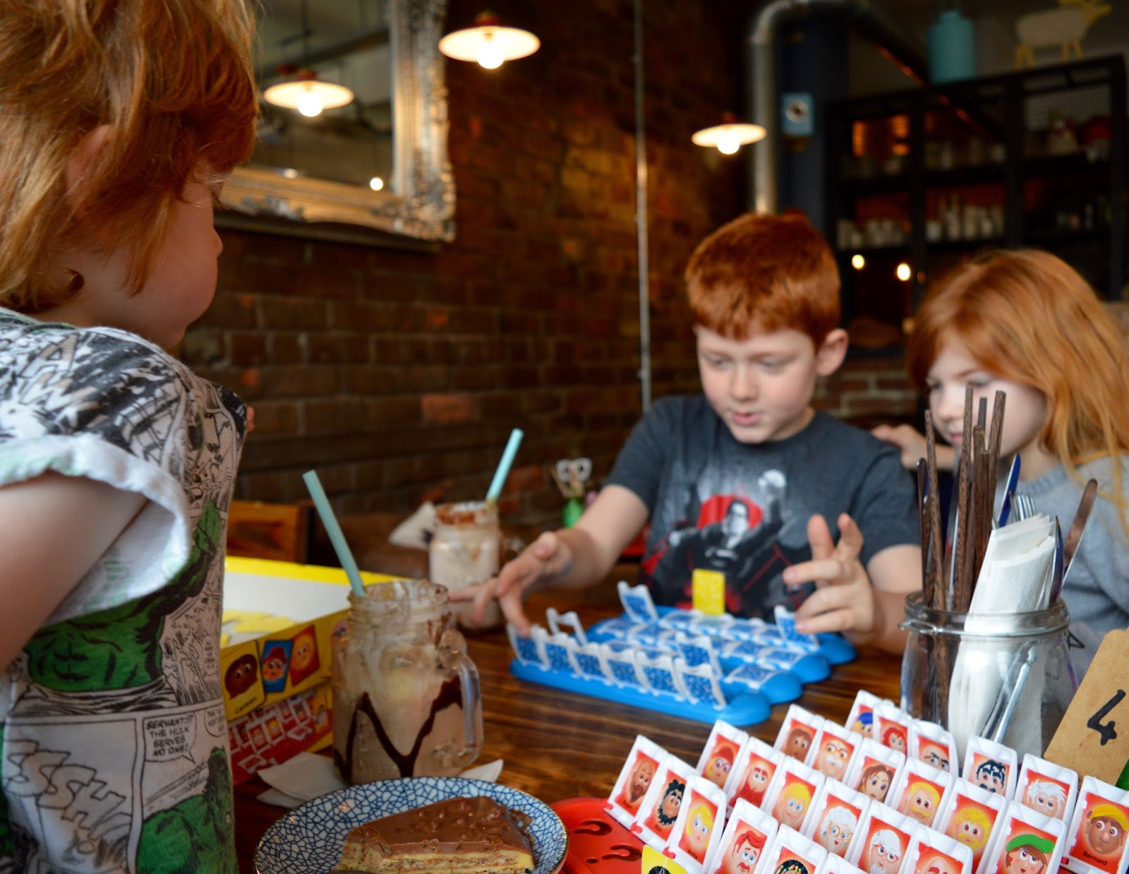 Meet and Treat Newcastle Cafe | A Perfect Spot for Pre-Theatre Drinks & Cakes with Kids for Tyne Theatre and Opera House - Kids playing Guess Who