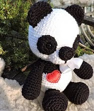 http://www.ravelry.com/patterns/library/the-panda-bear---amigurumi-crochet-pattern