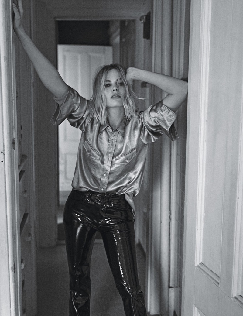 Margot Robbie wears Gucci shirt and Rag & Bone trousers