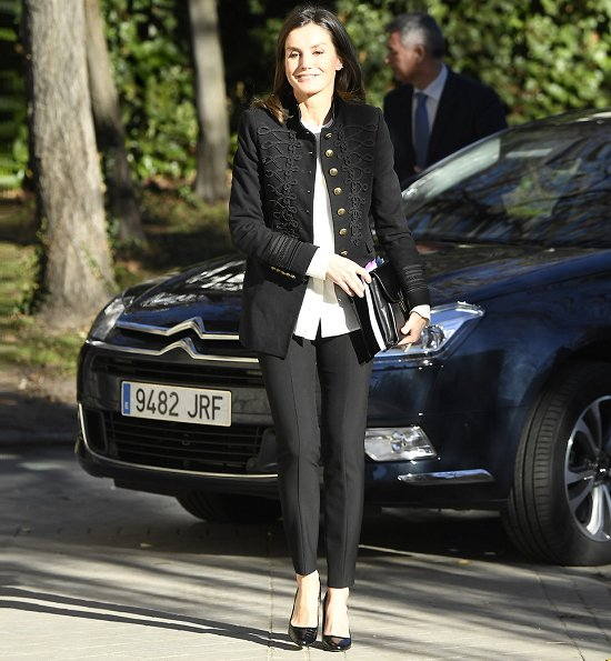 Queen Letizia wore Zara Velvet Military Jacket. Queen Letizia carried Hugo Boss fanila clutch. pearl earrings